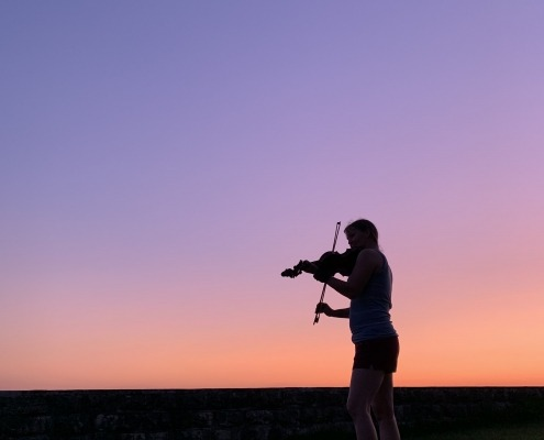 Enjoying the music at sunset