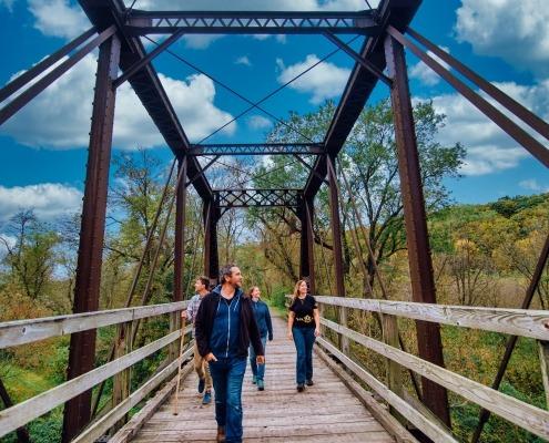 Walking across a bridge on a beautiful day